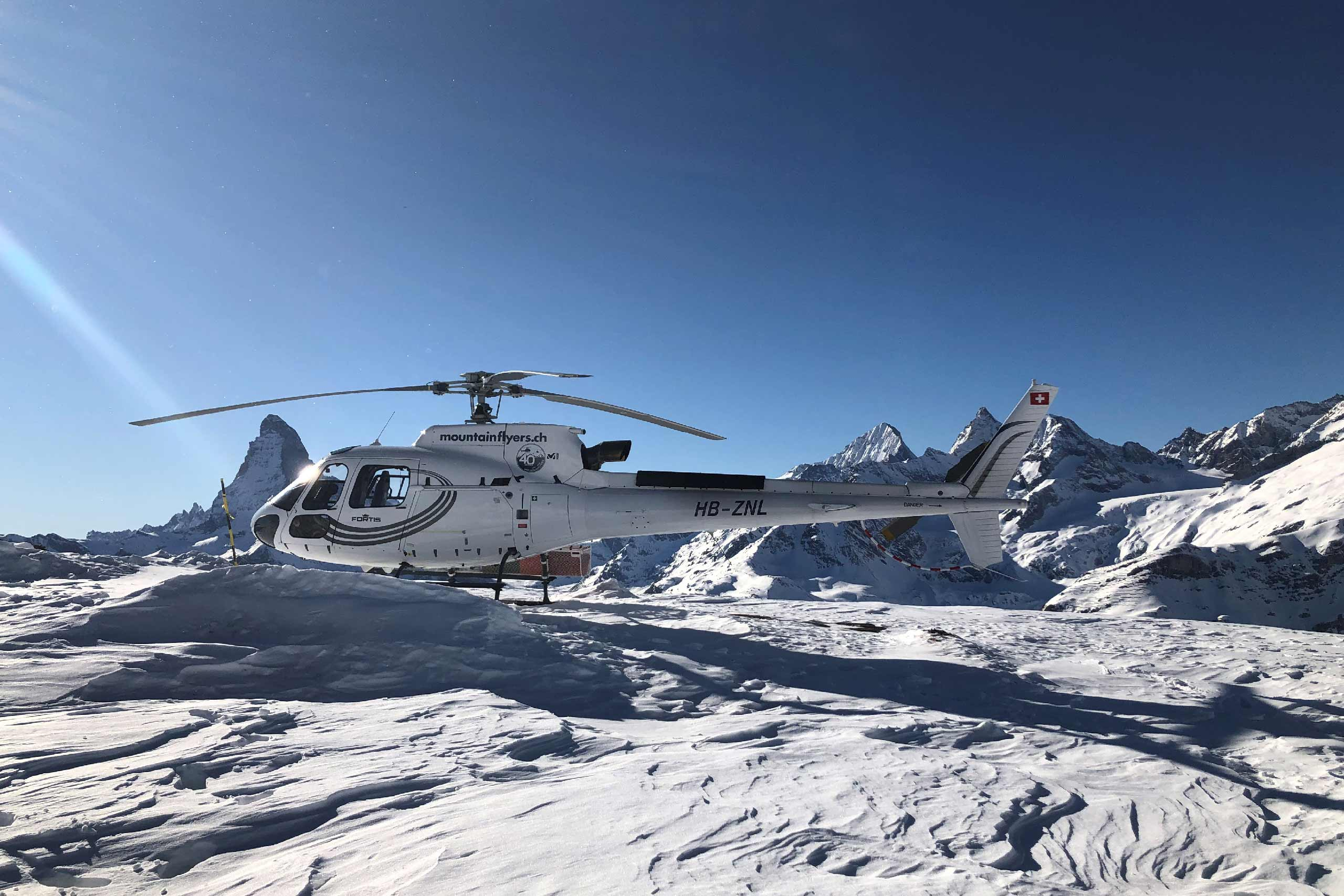 mountainflyer-helikopter-rundfluege-schnee-matterhorn.jpg