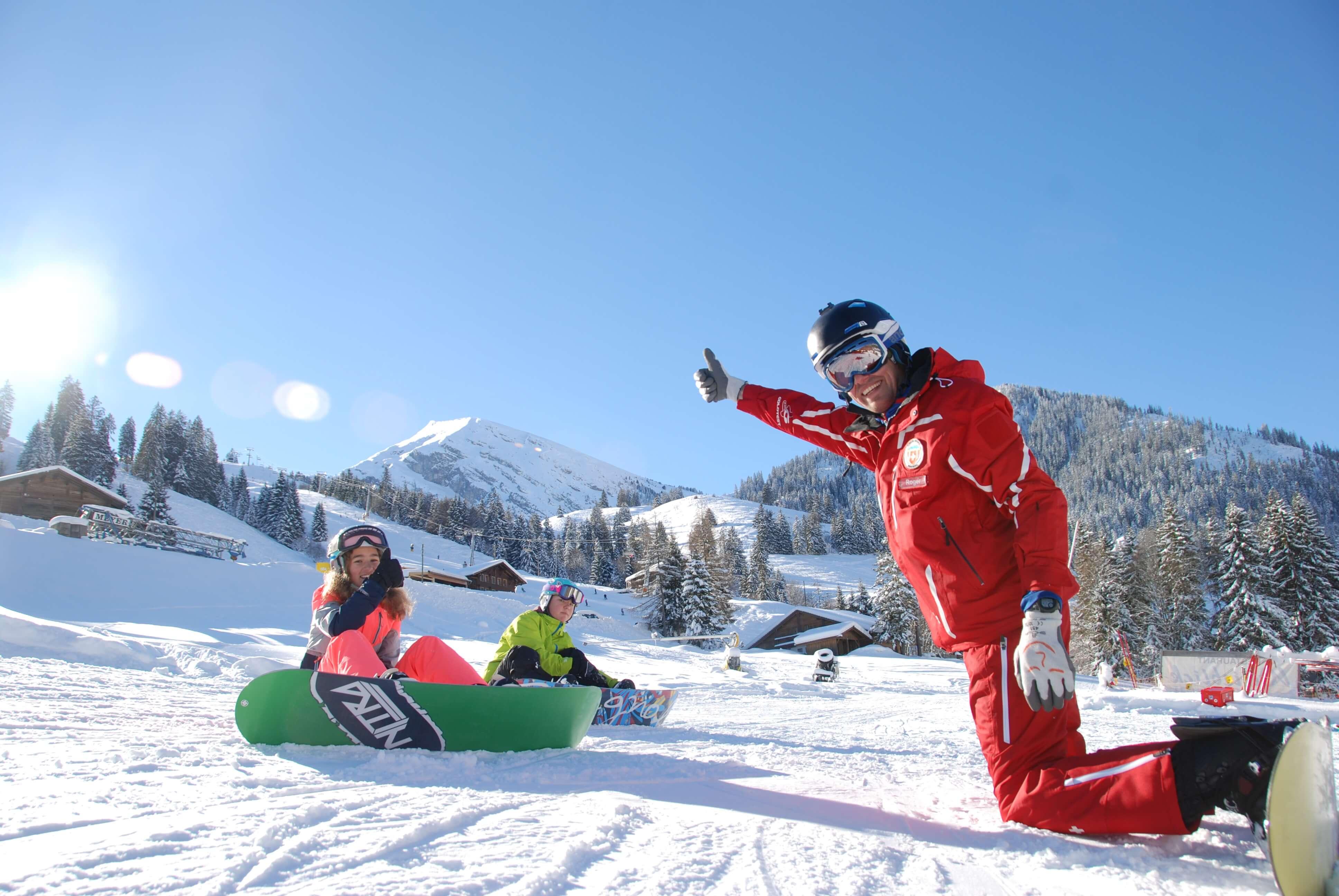 Snowboardunterricht am Wiriehorn vor toller Bergkulisse