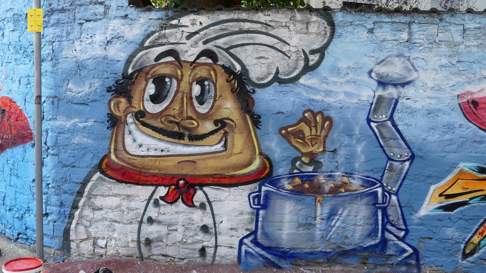 """Graffiti """"Suppenküche"""" an der Graffitimauer """"Busdorfgalerie"""""""