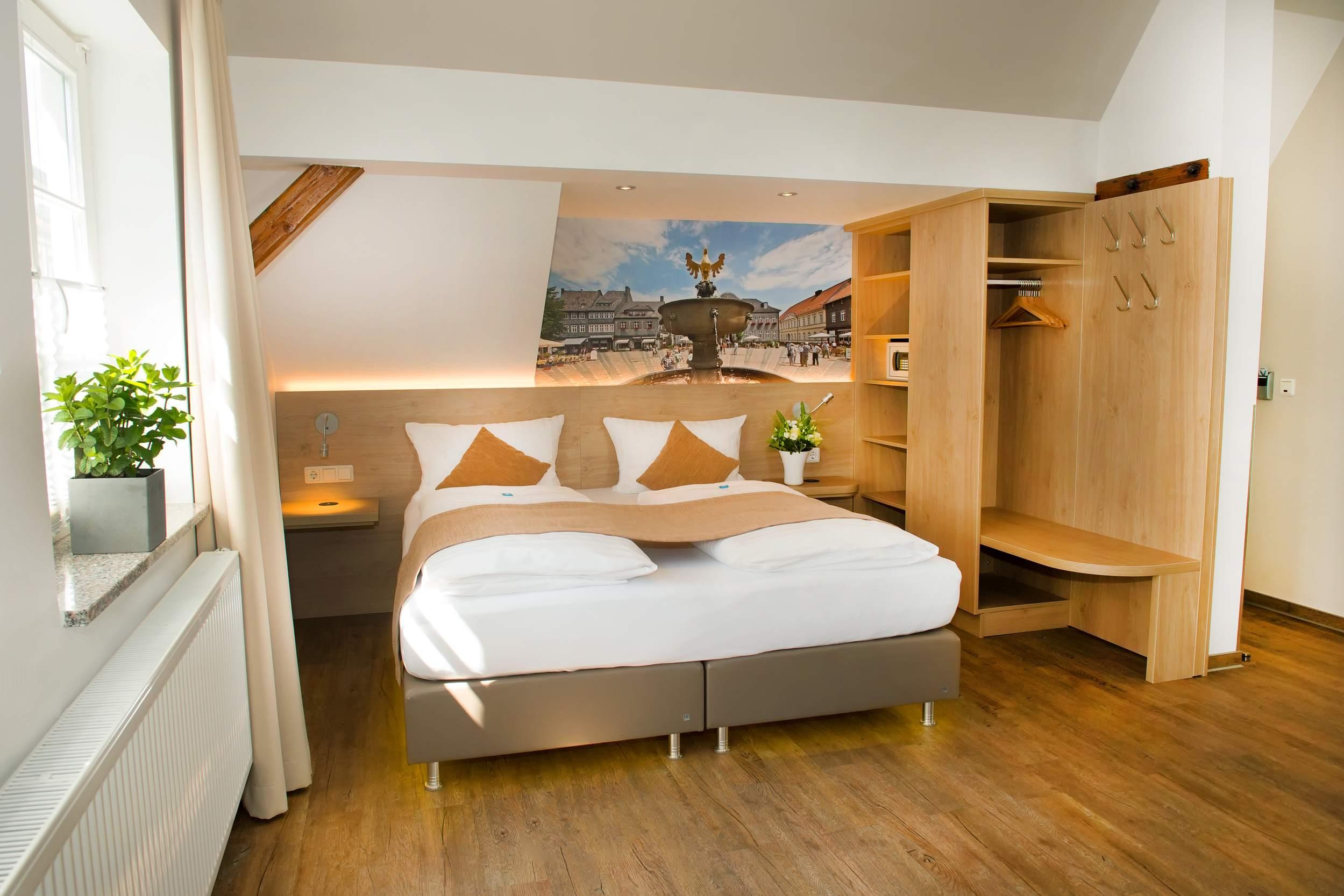 City Appartements am Wall Goslar - Schlafzimmer Bocksberg