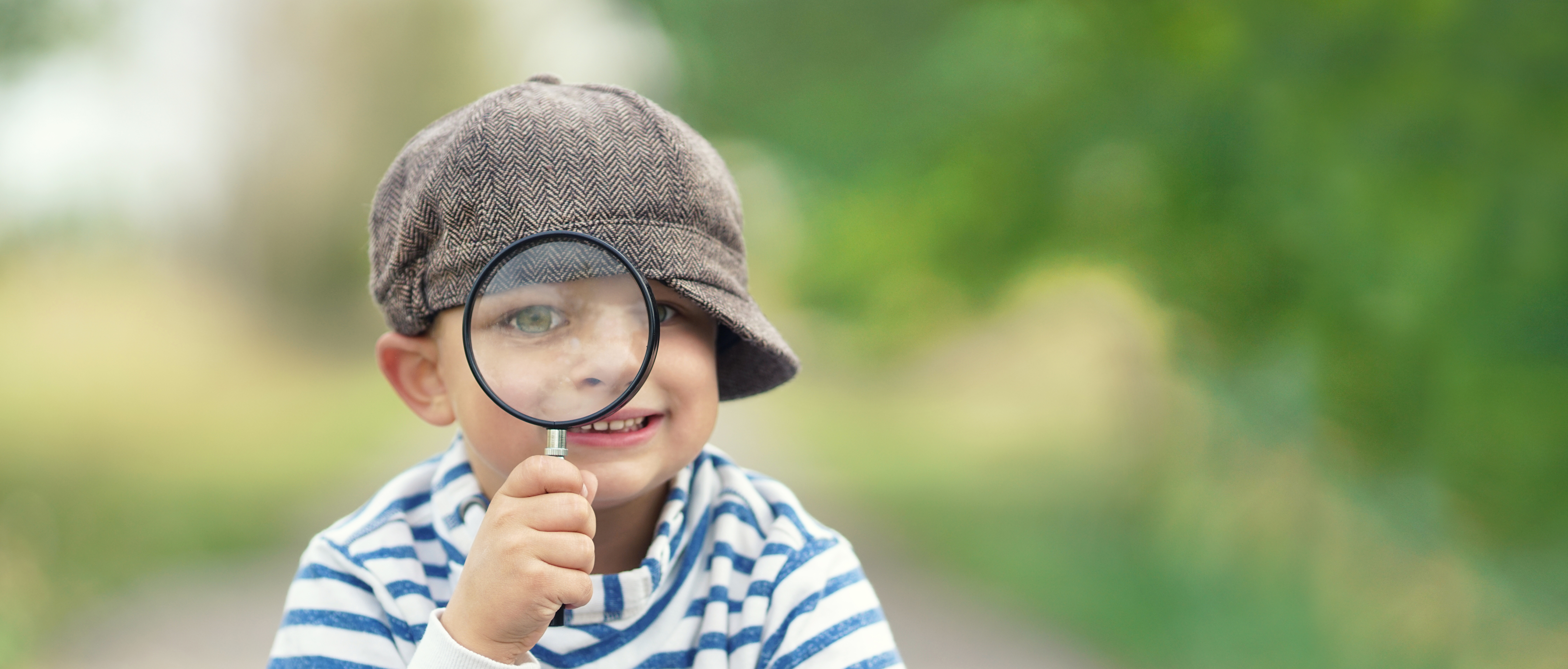 Inquisitive boy with magnifying glass