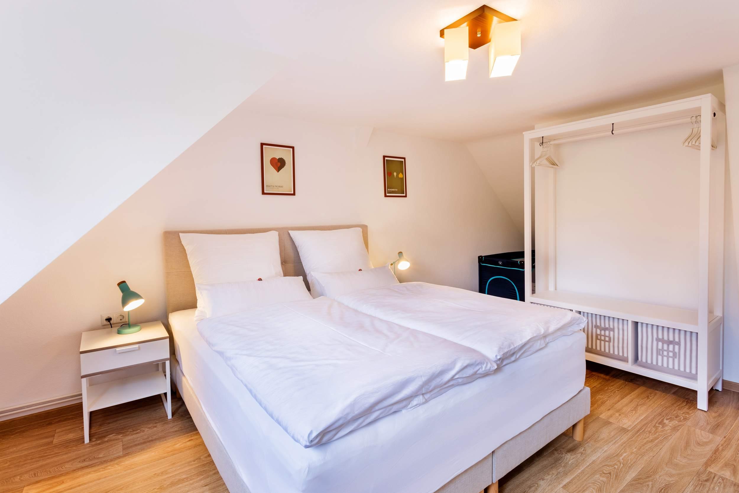 Ferienwohnung Bad Sachsa Harz - Schlafzimmer mit Kinderbett